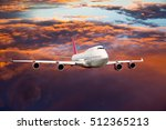 a passenger plane in the sunset ... | Shutterstock . vector #512365213