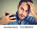 preoccupied shocked man feeling ... | Shutterstock . vector #512380303