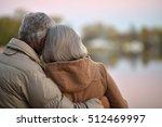 happy senior couple  near river | Shutterstock . vector #512469997