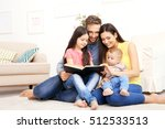 happy family reading book at... | Shutterstock . vector #512533513