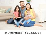happy family reading book at... | Shutterstock . vector #512533717