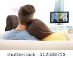 family watching tv on couch | Shutterstock . vector #512533753