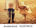 Family In Autumn Park.mom...