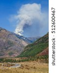 Small photo of Fire in the mountains, Altai Mountains, Siberia, Russia