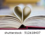 Opened Book With Heart Shaped...