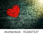 Small photo of Decorative heart on dark wooden background with bright white light from the window. The concept of fading love. The end of life. On the verge of death. The aging of the human body. Heart disease.