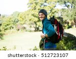 portrait of smiling male hiker... | Shutterstock . vector #512723107