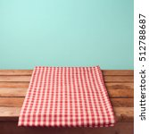empty wooden deck table and red ...   Shutterstock . vector #512788687