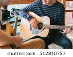 learning to play the guitar.... | Shutterstock . vector #512810737