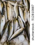 Small photo of Freshly caught bogue or Boops boops, gopa fishes in the box on the counter at the greek fish market. Bogue or Boops boops fishes background. Vertical. Top view.