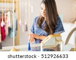 attractive young woman trying...   Shutterstock . vector #512926633