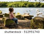 Cute Little Girl Sitting On A...
