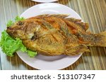 Fried Fish On Wood Table