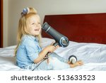 little girl with curlers on her ... | Shutterstock . vector #513633523
