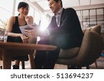 two business people sitting at... | Shutterstock . vector #513694237