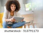 mixed race woman websurfing on... | Shutterstock . vector #513791173