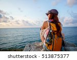 girl with backpack sitting on... | Shutterstock . vector #513875377