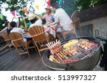 family having a barbecue party... | Shutterstock . vector #513997327