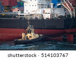 Ship Berthing At Port With Tug...