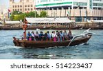 Small photo of DUBAI, UNITED ARAB EMIRATES (UAE)-DECEMBER 5,2013 : People crossing the Creek from Deira to Bur by abra, a traditional wooden water taxi in Dubai, United Arab Emirates