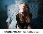 beautiful woman is vaping. dark ... | Shutterstock . vector #514389613
