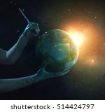 two hands painting the planet...   Shutterstock . vector #514424797
