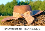The Woven Hat Forgotten On The...