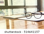 close up of eye glasses on work ... | Shutterstock . vector #514641157
