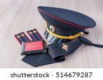 Small photo of Still Life: cap, tie straps police lieutenant colonel and a pension certificate AMIA Russia