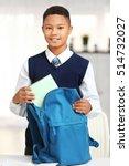 cute schoolboy putting book...   Shutterstock . vector #514732027