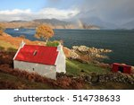 A Red Roofed Cottage On A...