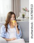 beautiful young woman drinking... | Shutterstock . vector #514780513