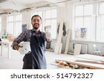 happy young painter holding... | Shutterstock . vector #514792327