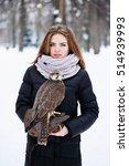 Young Woman Holding A Falcon O...