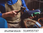 artisan holding a boot and... | Shutterstock . vector #514955737