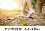 woman runner in sneakers during ... | Shutterstock . vector #515015527