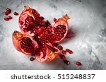 half pomegranate and seeds... | Shutterstock . vector #515248837
