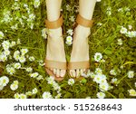 female legs in sandals on a... | Shutterstock . vector #515268643