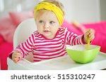 cheerful happy baby child eats... | Shutterstock . vector #515310247