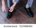groom tying shoelaces | Shutterstock . vector #515488483