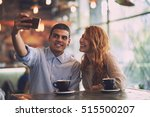 making selfie in the cafe | Shutterstock . vector #515500207