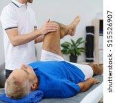 physiotherapist flexing an... | Shutterstock . vector #515526907