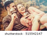 cute young couple drinking red... | Shutterstock . vector #515542147
