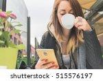 attractive girl using... | Shutterstock . vector #515576197