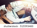 businessman driving a car.