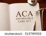 Small photo of Page with ACA (Affordable Care Act) on the table with stethoscope, medical concept