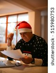 senior man with santa claus hat ... | Shutterstock . vector #515980753