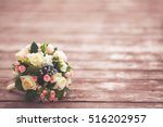 Small photo of Beautiful wedding bouquet on wooden background, vintage toned, copyspace. Marriage concept