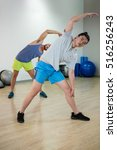 Small photo of Two men doing aerobic exercise in fitness studio