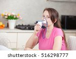 young woman doing inhalation... | Shutterstock . vector #516298777